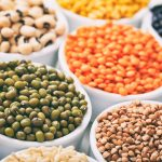 various-raw-legumes-and-rice-in-bowls-PHHP88P
